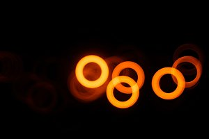 Horizontal orange bokeh circles illustration background