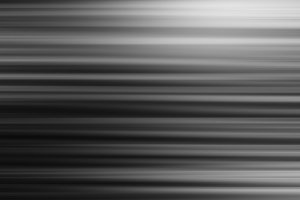 Horizontal black and white motion blur bokeh background