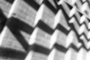 Diagonal black and white bokeh background