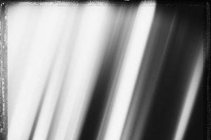 Diagonal black and white film scan motion blur background