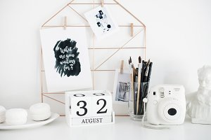 Stylish white desktop, home office interior details with camera
