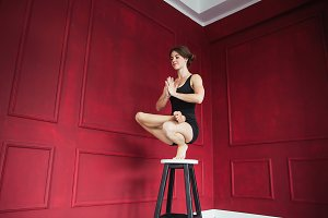 Yoga woman in red room