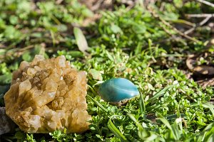 blue and yellow gemstone on grass