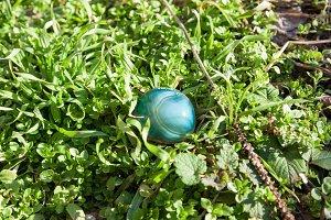 blue gemstone on grass