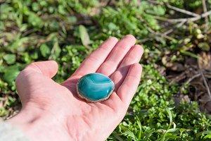 blue gemstone in hand