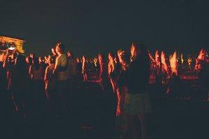 Festival blurred figures at concert