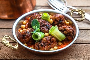 izmir kofte - Turkish traditional meatball with chickpeas. tomato sauce and mint