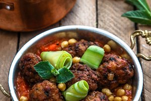 izmir kofte, Turkish traditional meatballs in copper pan with spicy chickpeas