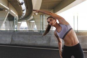 Sportswoman doing exercise