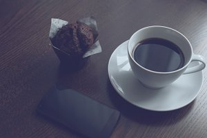 Smartphone, coffee and muffin