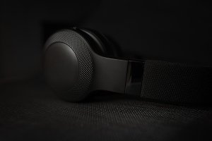 Black headphones in dark