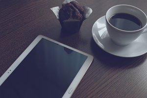 Tablet coffee and muffin