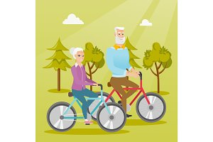 Happy senior couple riding on bicycles in park.