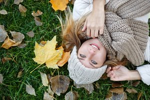 Girl lying on the fallen leaves