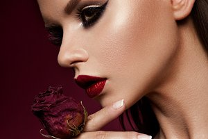 Red Lips and Smoky Eyes Make up. Glamour Lady Portrait.
