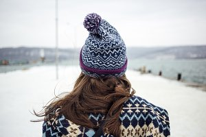 Girl near the sea in winter