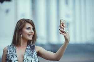 Woman make selfie on smartphone