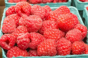 Red raspberries in a box