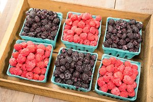 Wooden crate of raspberries