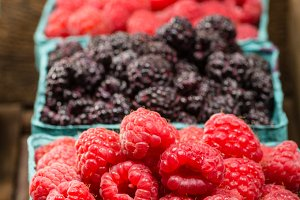 Closeup red and black raspberries