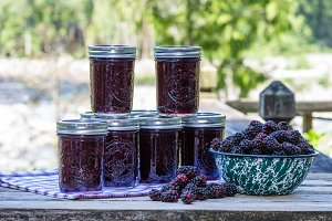 Blackberries and jars of jam