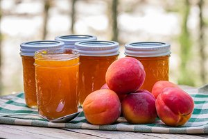 Apricots and jars of preserves