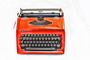 Abstract Orange Typewriter on white
