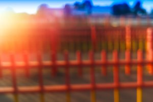 Red fence with light leak bokeh background