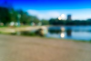 Summer park with lake bokeh background