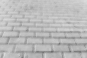 Diagonal black and white bricks bokeh background