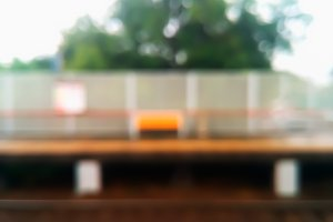Horizontal railway station with bench bokeh background