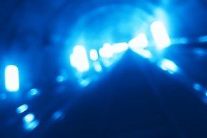 Diagonal cyan lights bokeh background