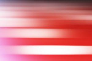 Horizontal pink motion blur with light leak  background