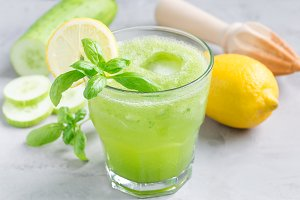 Healthy lemonade with cucumber, basil, lemon, honey and sparkling water, horizontal