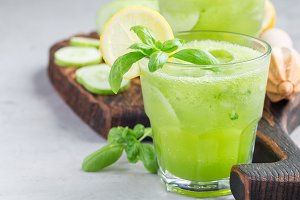 Healthy lemonade with cucumber, basil, lemon, honey and sparkling water, horizontal, copy space
