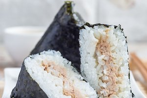 Korean triangle kimbap Samgak with nori, rice and tuna fish, similar to Japanese rice ball onigiri. Vertical, copy space