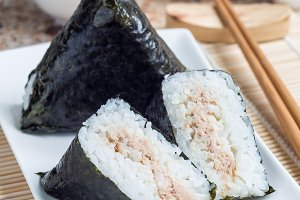 Korean triangle kimbap Samgak with nori, rice and tuna fish, similar to Japanese rice ball onigiri. Vertical