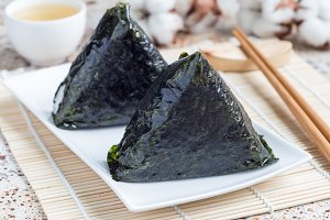 Korean triangle kimbap Samgak with nori, rice and tuna fish, similar to Japanese rice ball onigiri. Horizontal