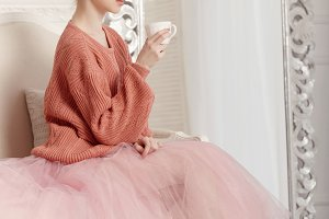 Ballerina drinking tea