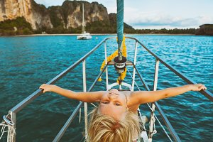 Little child on sailing yacht
