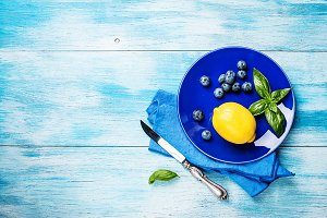 fresh lemon on blue plate