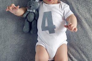 newborn to four months lying