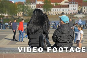 Mother with son relax in the city and watch sport games - slowmo 180 fps