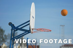 The basketball ball flies into the basket - slowmotion 180 fps