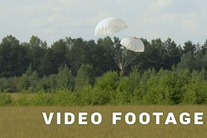 Skydiver dangerous landing with two parachutes to trees - slowmotion 60fps