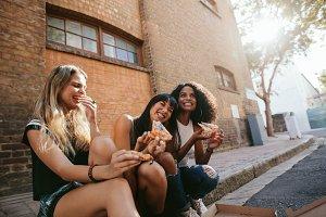 Beautiful girls sitting outdoors