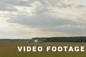 The plane take off from the field - slowmotion 60fps