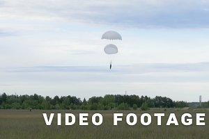 Skydiver landing with two parachutes - slowmotion 60fps