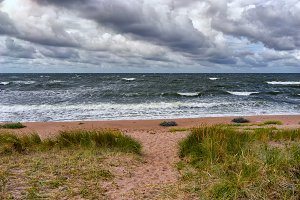 The sandy beach of the Baltic in a storm