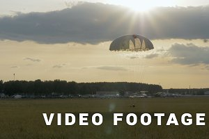 Skydiver landing with parachutes - slowmotion 60fps